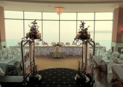 Candle stands framing sea view top table