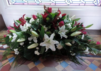 White and red luxury funeral spray